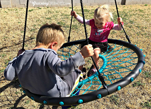 Kids Playing on Tarzan Tire Swing in Backyard